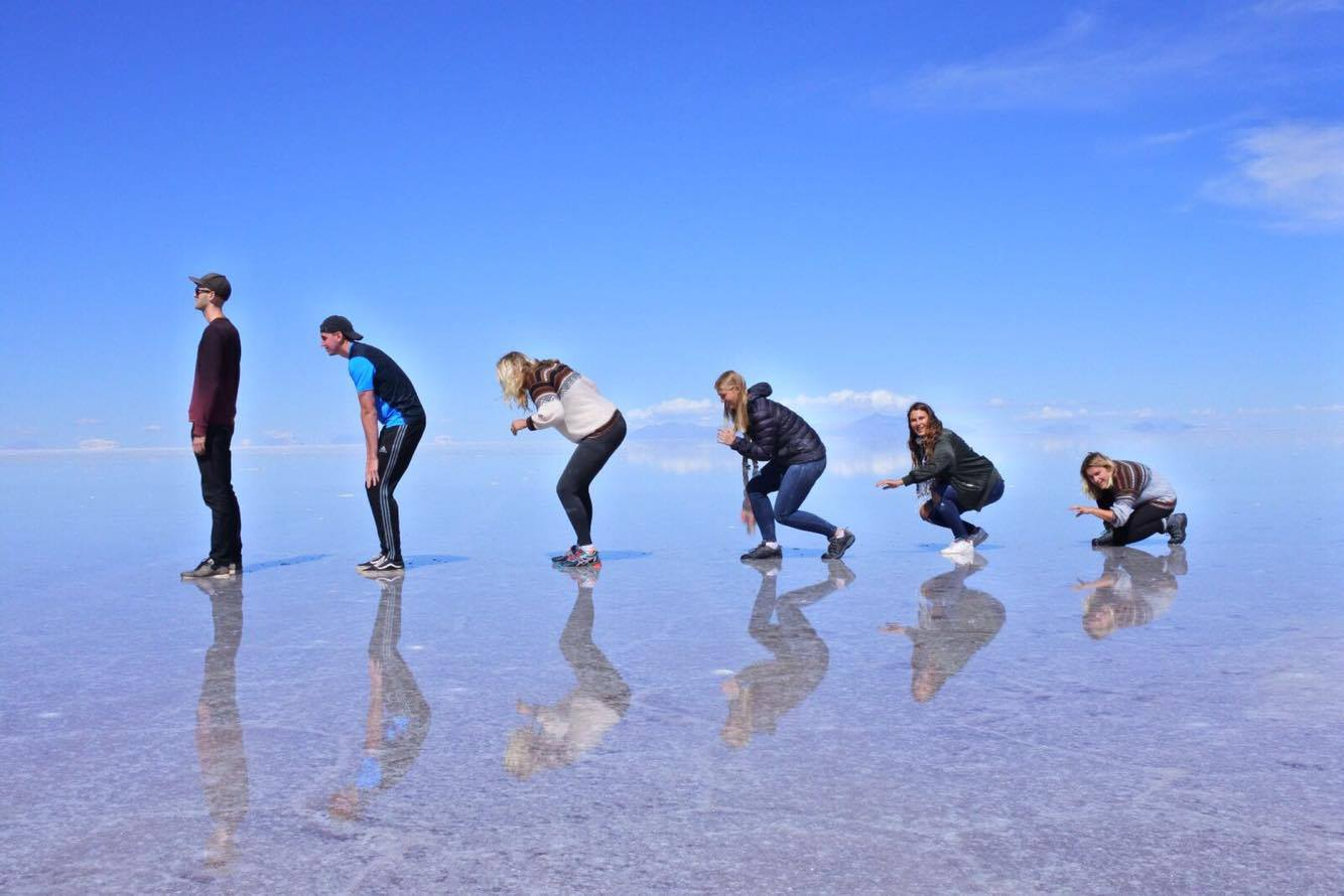 Goofing around with new found friends on the salt flats in Bolivia - Emma