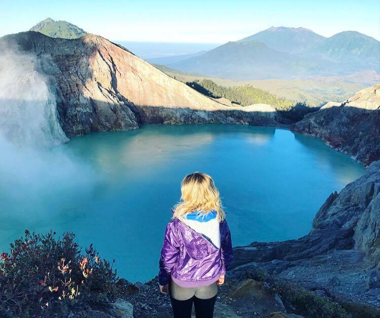 Standing on the crater of the largest acid lake in the world, Kawah Ijen
