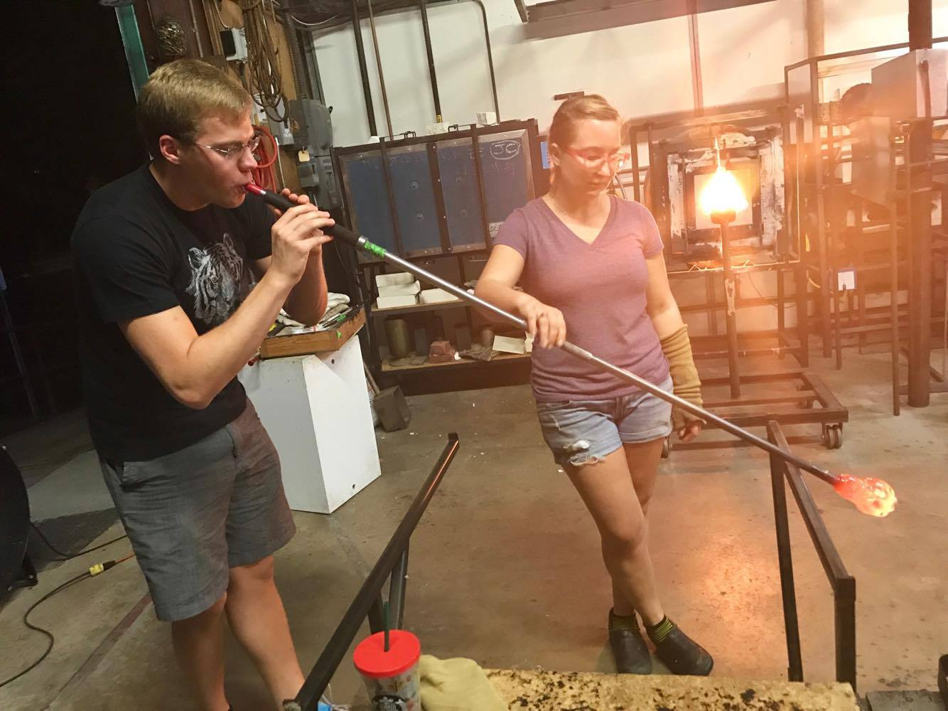 Blowing the Glass After Molding into Pumpkin Form - Decatur Glassblowing