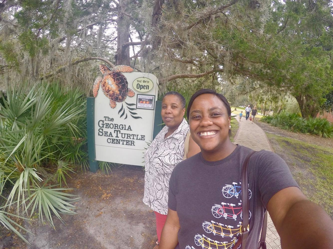 Mom and I in Front the of the Welcome Sign - The Georgia Sea Turtle Center
