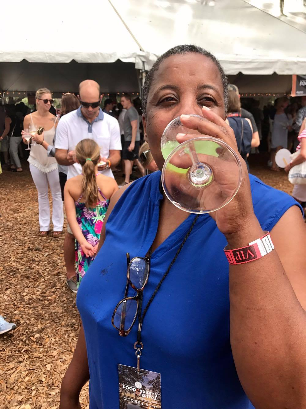 Tasting Under the Oaks - MJ sampling some drink - St Simons Food Spirits Festival