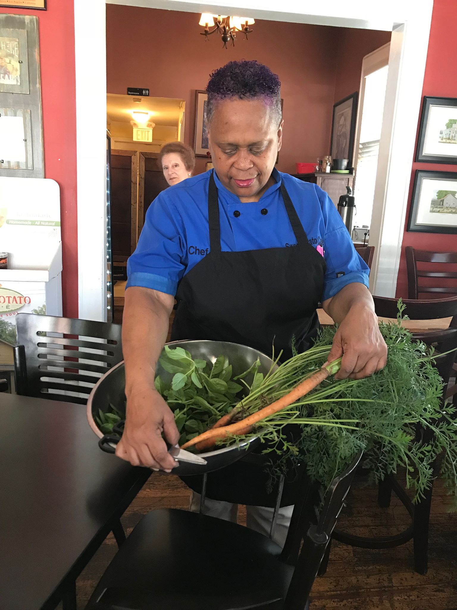 Chef Karen Pulling from the Garden - Sweet Potato Cafe