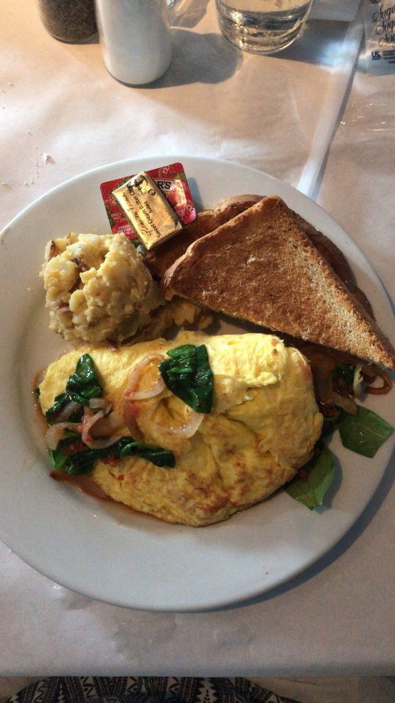 Omelette with Onions, Tomatoes, & Spinach - Savannah