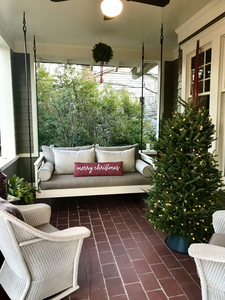 Marietta Pilgrimage - House 3; beautiful porch swing with Merry Christmas pillow and lit up mini Christmas tree